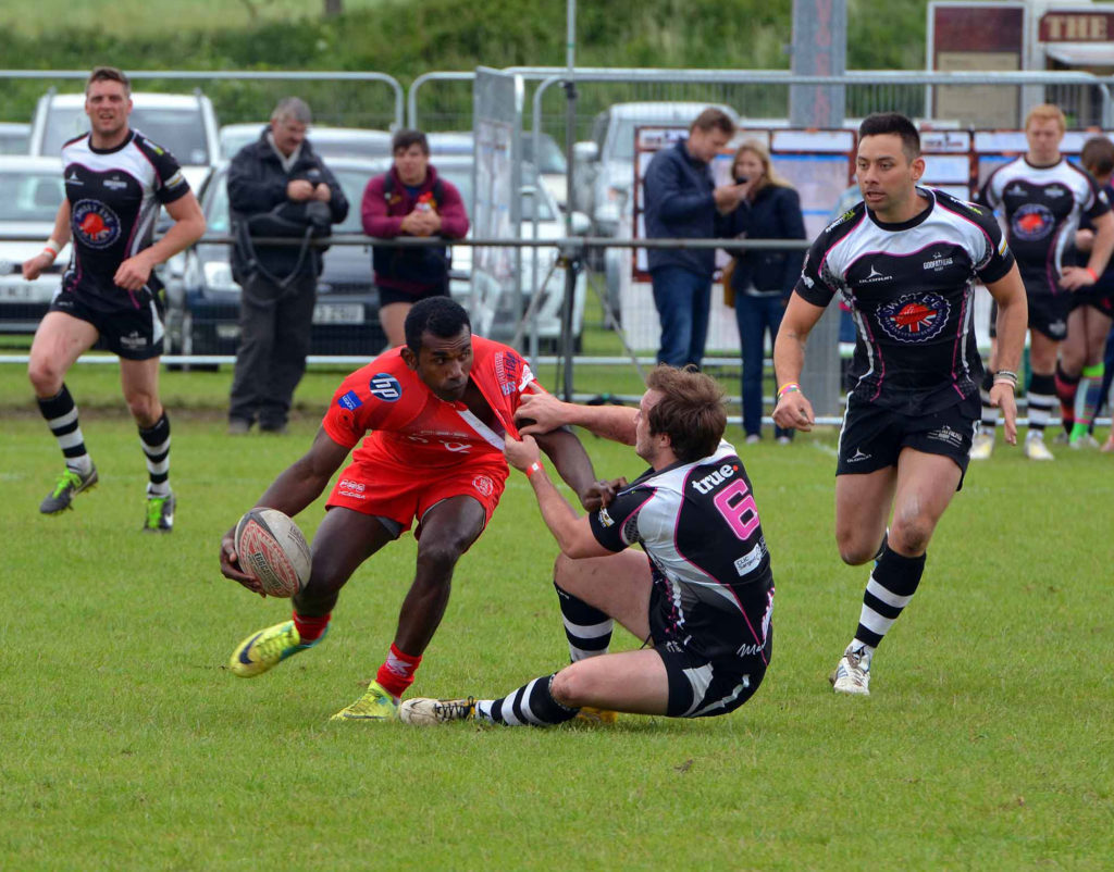 Cpl Tamatawale off loading in the tackle to keep the pressure on.