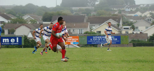 Cpl Swann charging down the field with four Apache players in pursuit