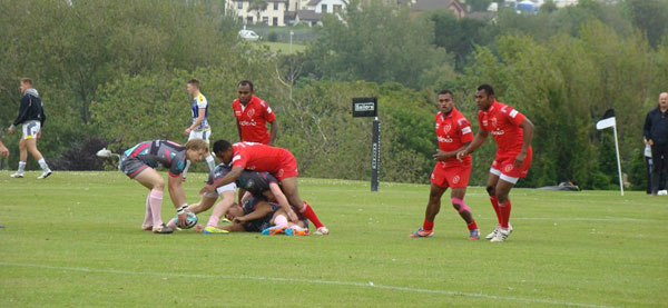 Cpl Swann applying pressure at the tackle against North Wales Exiles