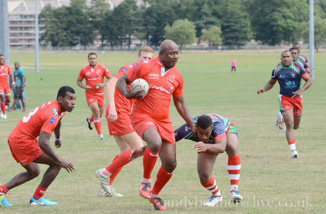 Army 7s Coach (LSgt Vanua) leading the charge (can-can) remembering how it was done in the past!