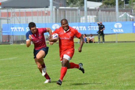 Raloka galloping down the park to score a try against the Crawshey's