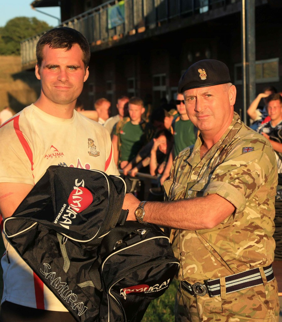 Col Andy Deans presents Player of the Tournament to Jamie Miller (YORKS).