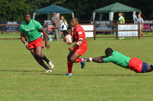 Koms Komaiyasa dancing through the Kenyans defence