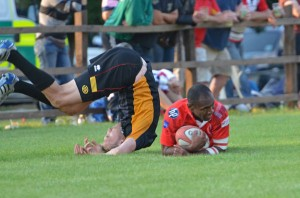 Koms Komaiyasa showing how to score a try rather than a football dive!