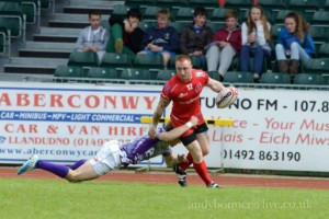 LCpl Deeke Morse off loading in the tackle by a dominant Thistles defence