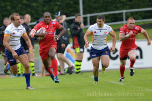 LCpl Matereti Komaiyasa showing his pace charging up the pitch in the rain