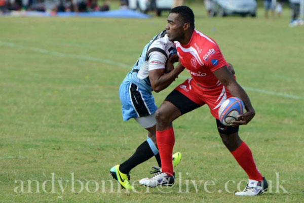 LCpl Ifereimi Vukinavanua showing how to off load in the tackle