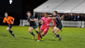 Cpl Alex Swann breaking through the tackle on one of his many charges up the field