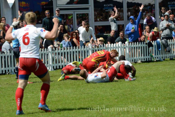 Lt Luke Robinson celebrating Cpl Raloka scoring a try with his bully run