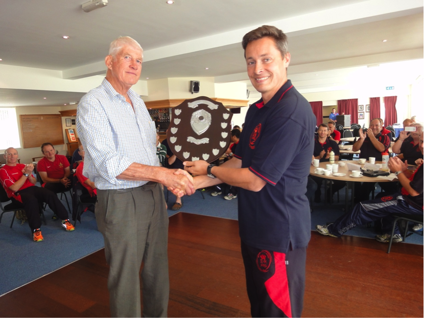 Richard receiving his award during the ARURS Training Day by Chairman Col Dave Wakefield