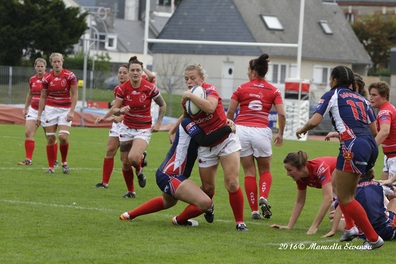 Sarah Batley taking the tackle with 25th cap winner Rae Matters in support